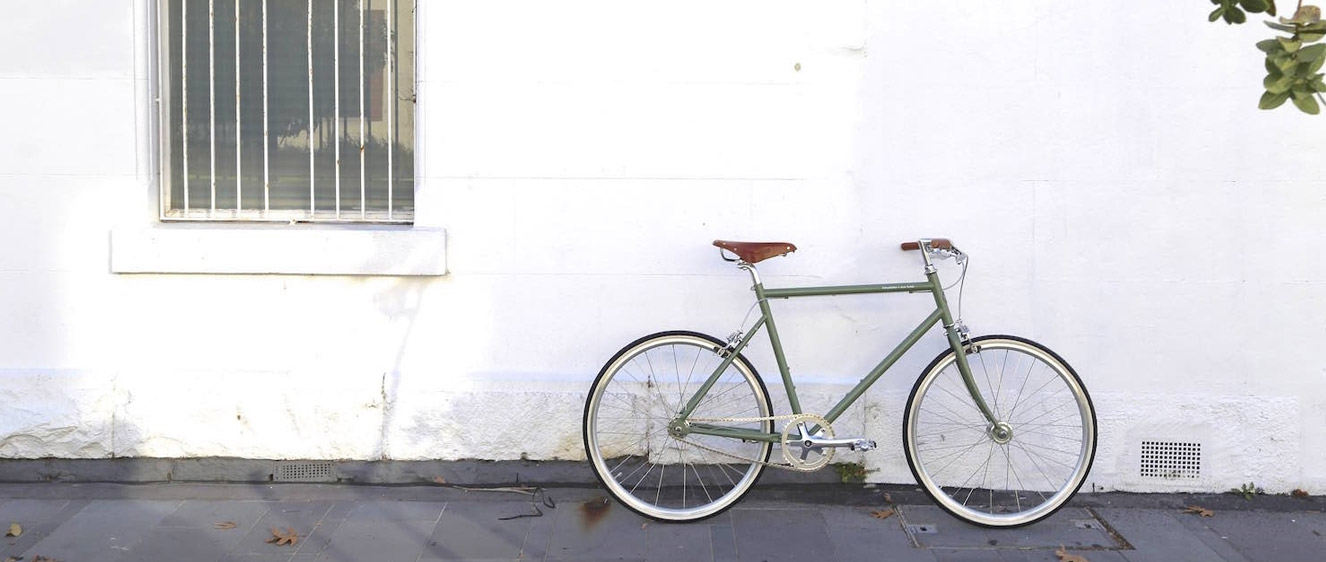 Bike leaning against a white wall