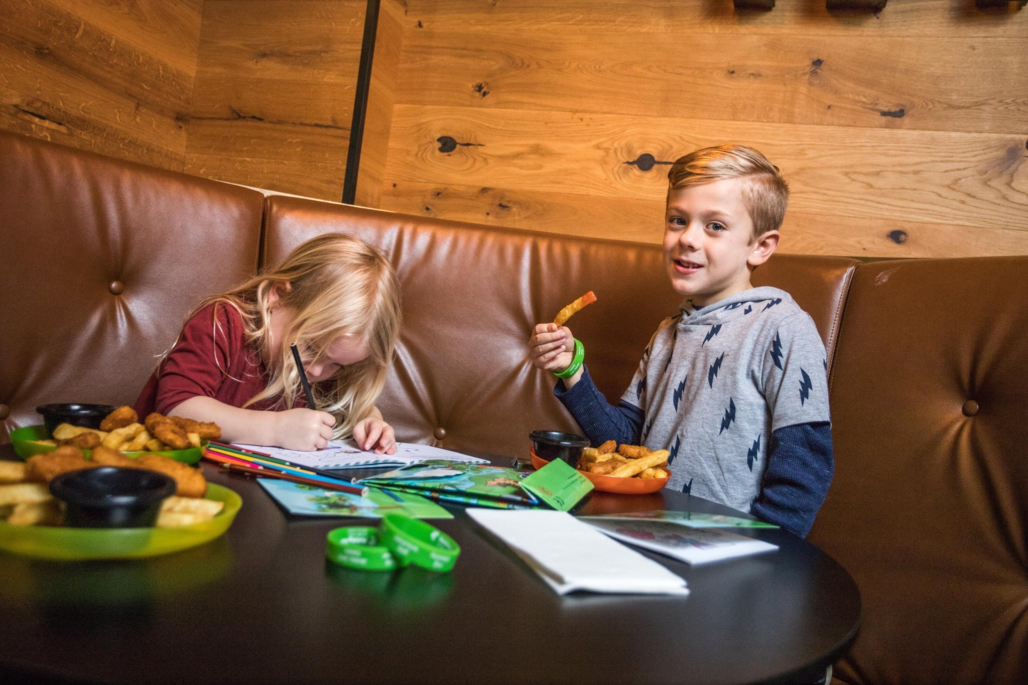 Kids eating a meal and colouring at Ivy & Jack restaurant