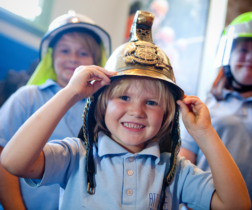 Child with fireman hat on