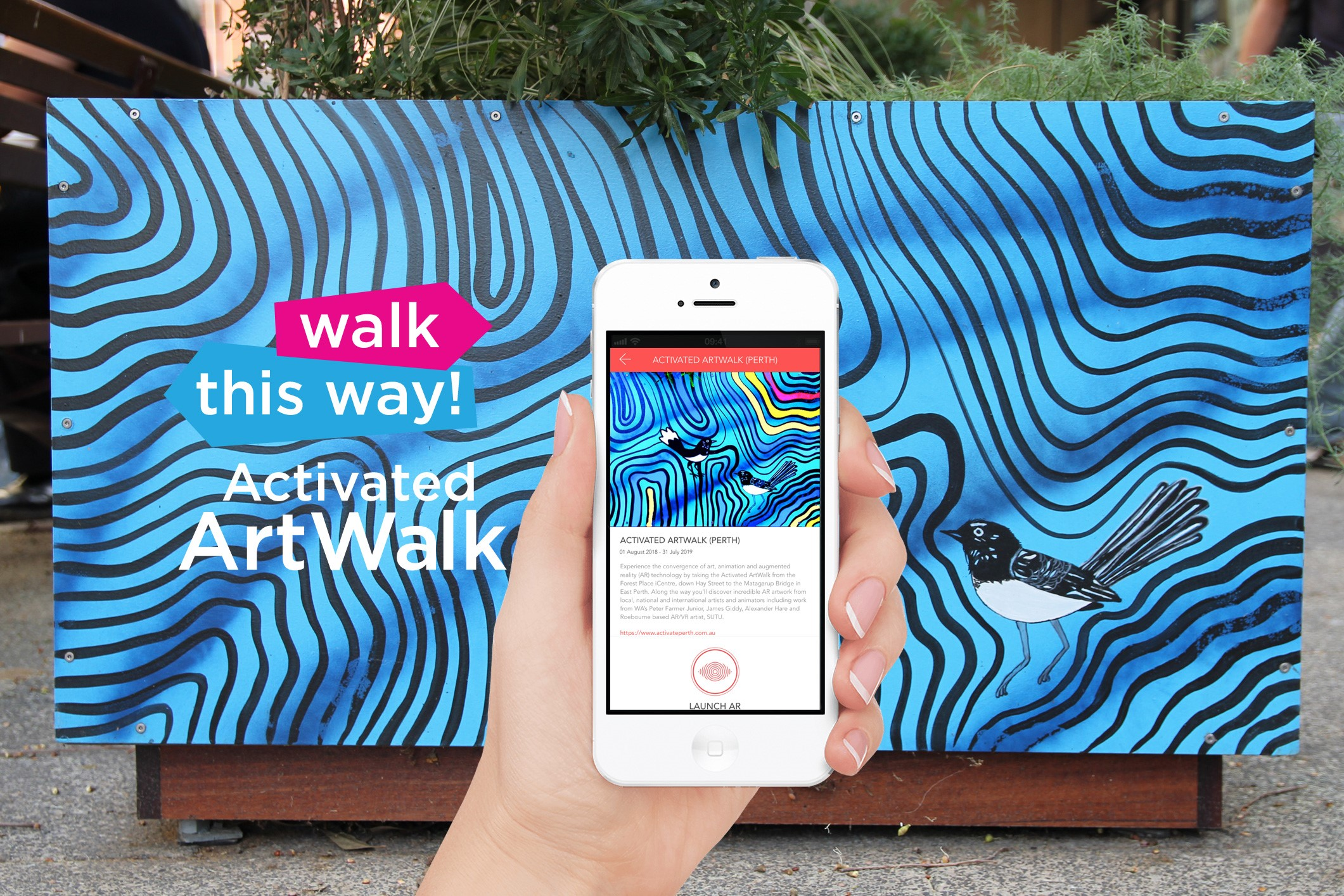 Person holding phone with Art Walk app on it in front of artwork