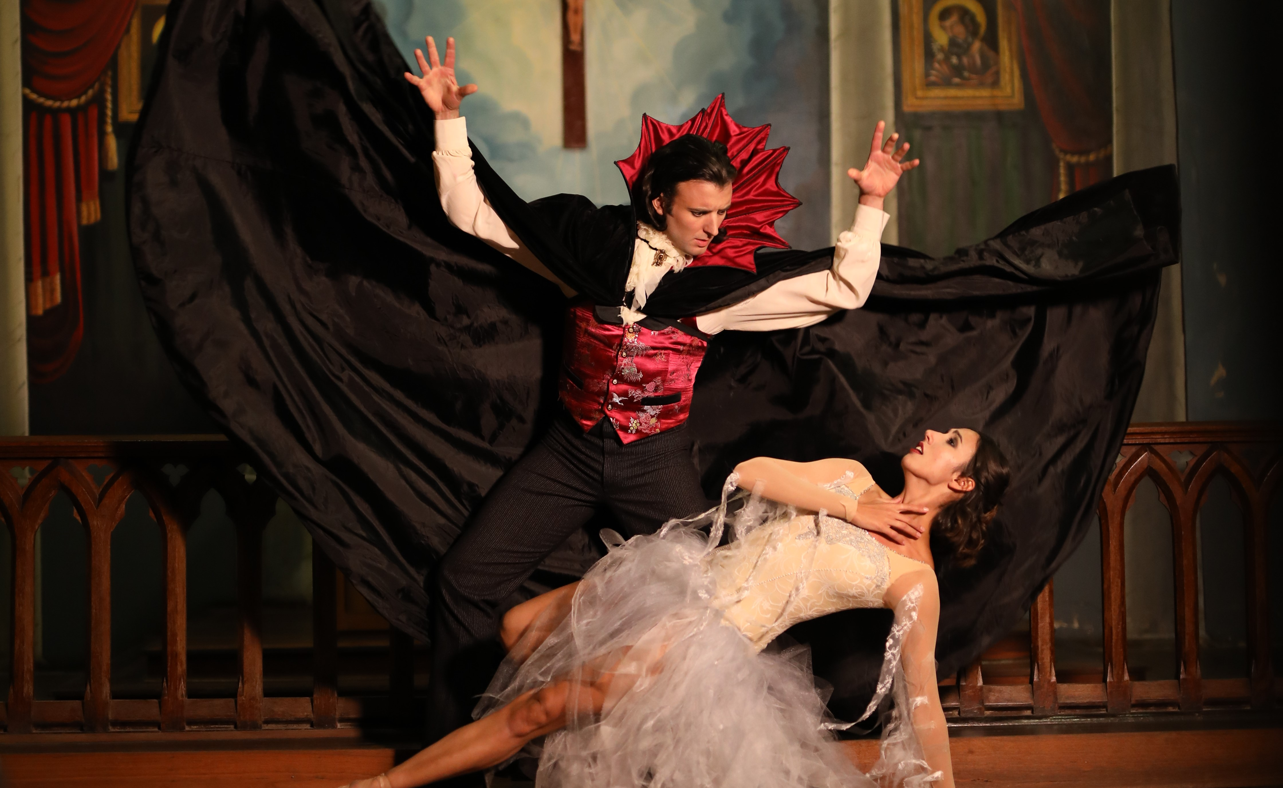 Dracula leaning over his love