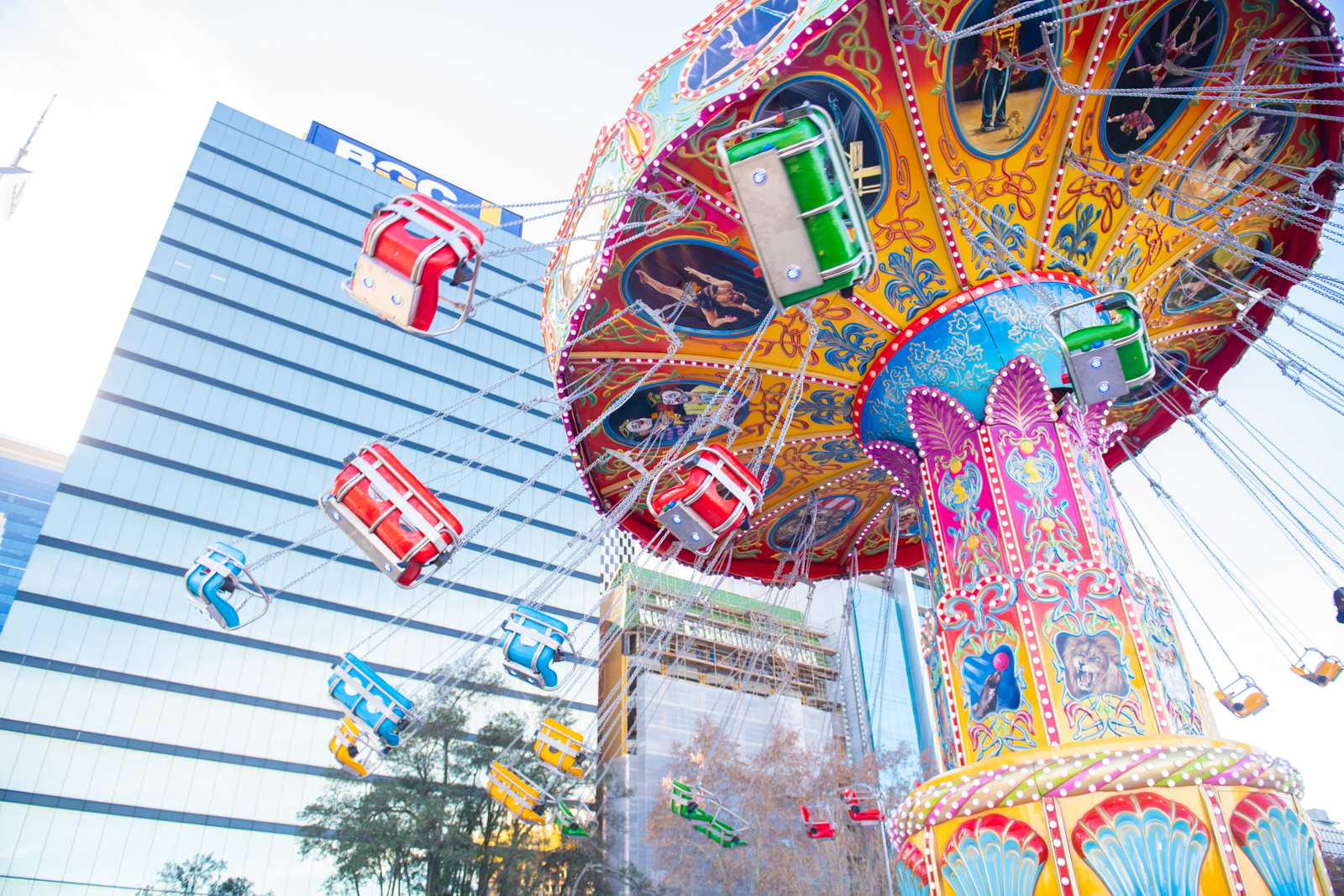 The Dream Swinger ride at Elizabeth Quay with buildings in the background