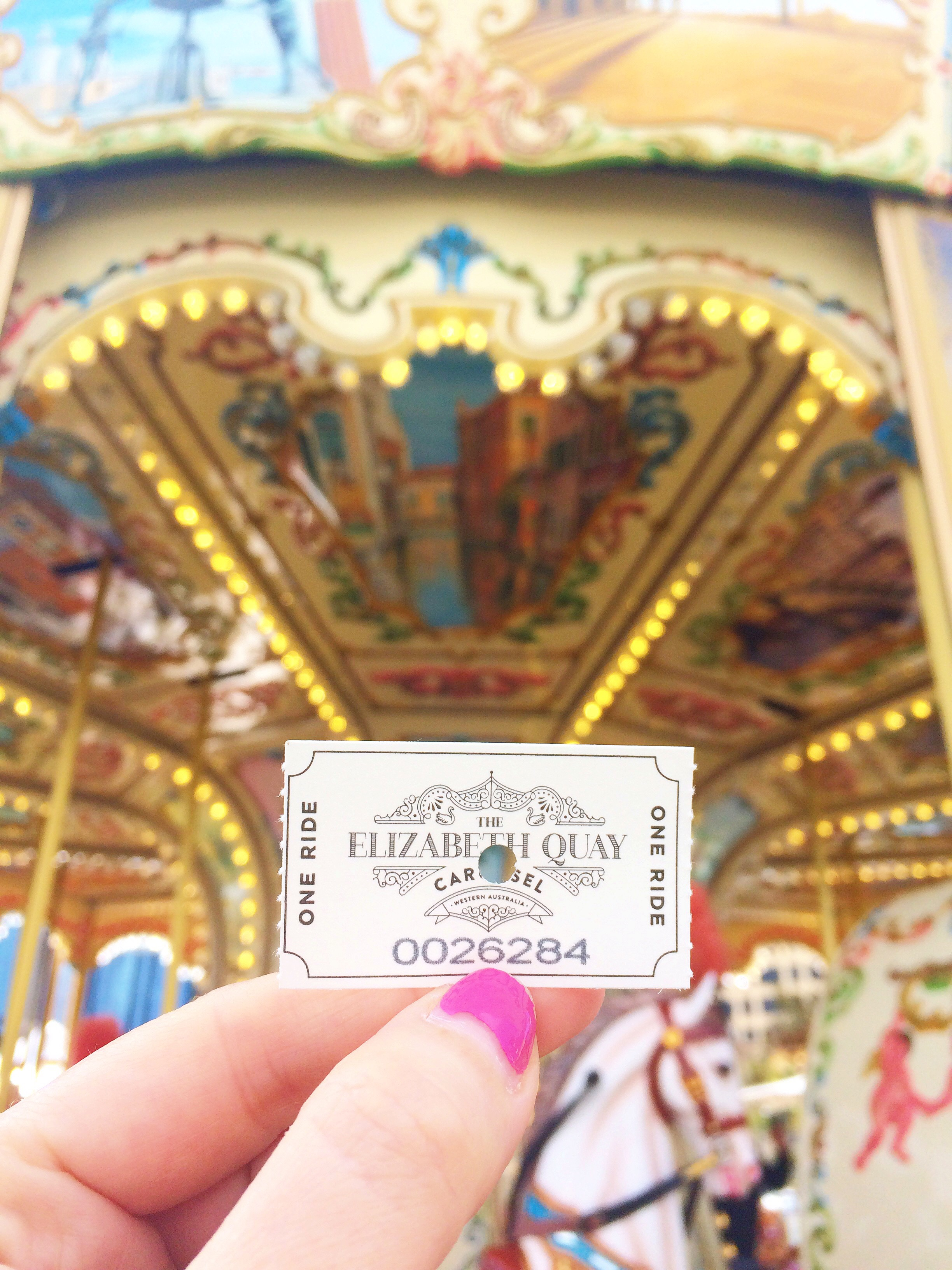 ticket held up in front of the carousel