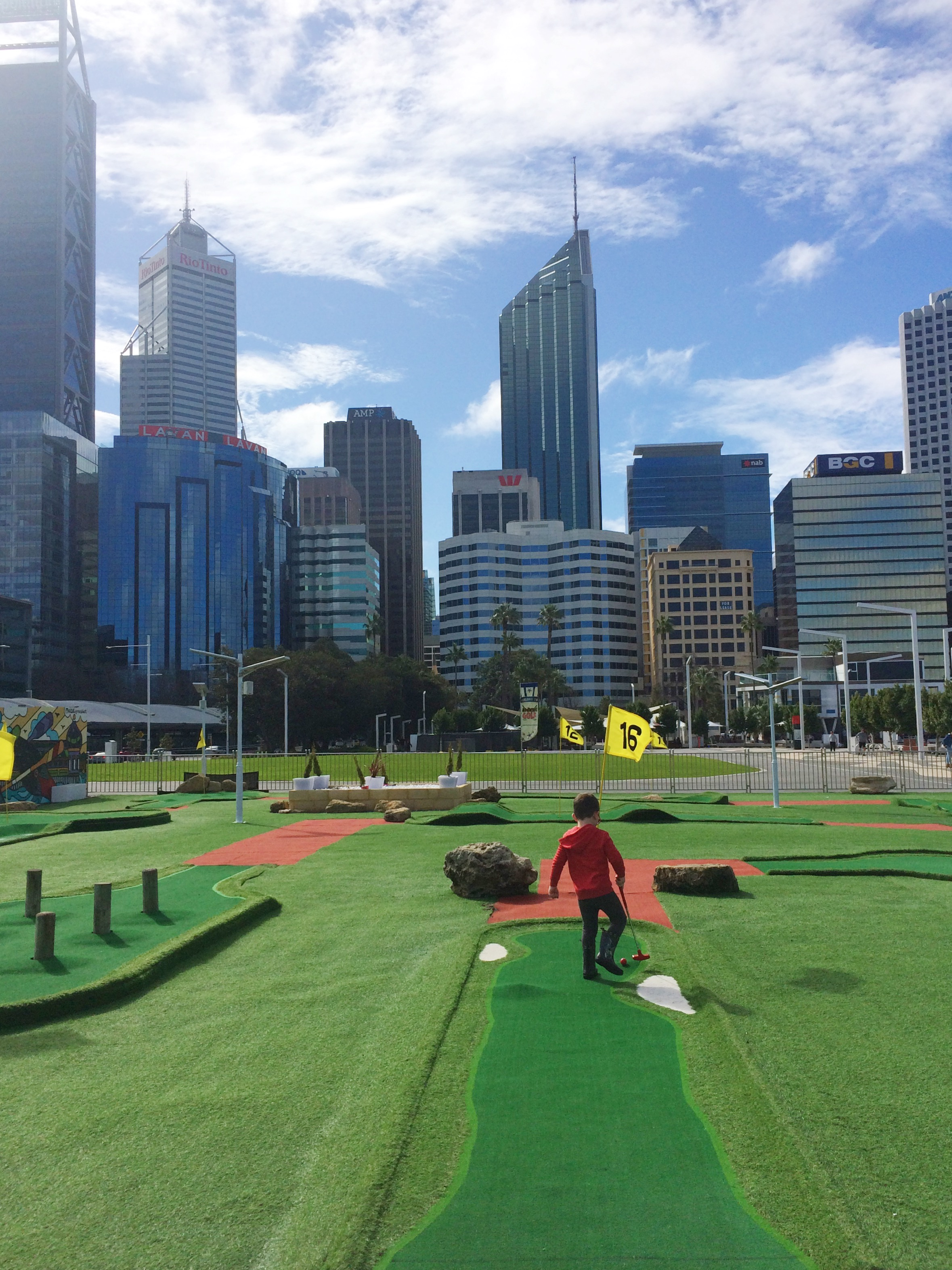 Child playing adventure golf in perth city