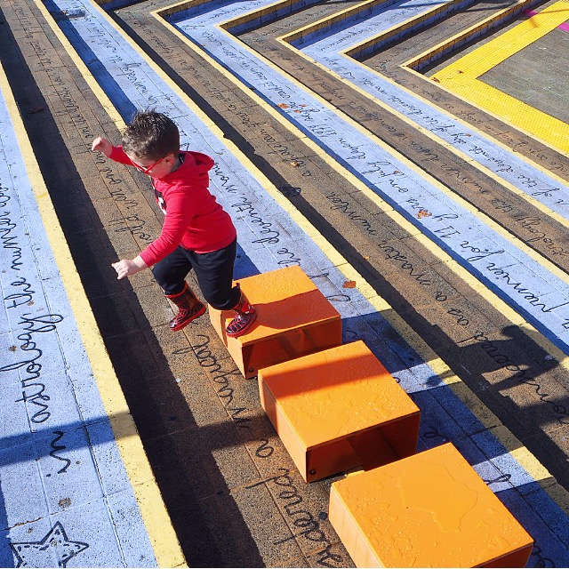 Child running up colourful stairs at the Perth Cultural Centre