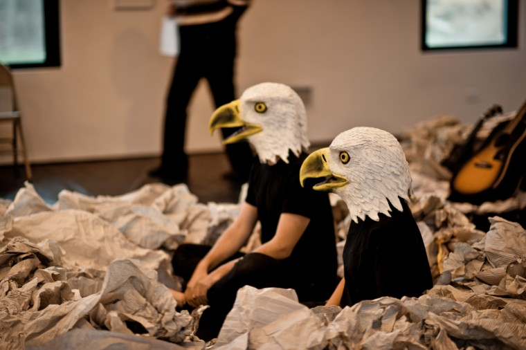 Actors dressed in eagle costumes at Blue Room Theatre