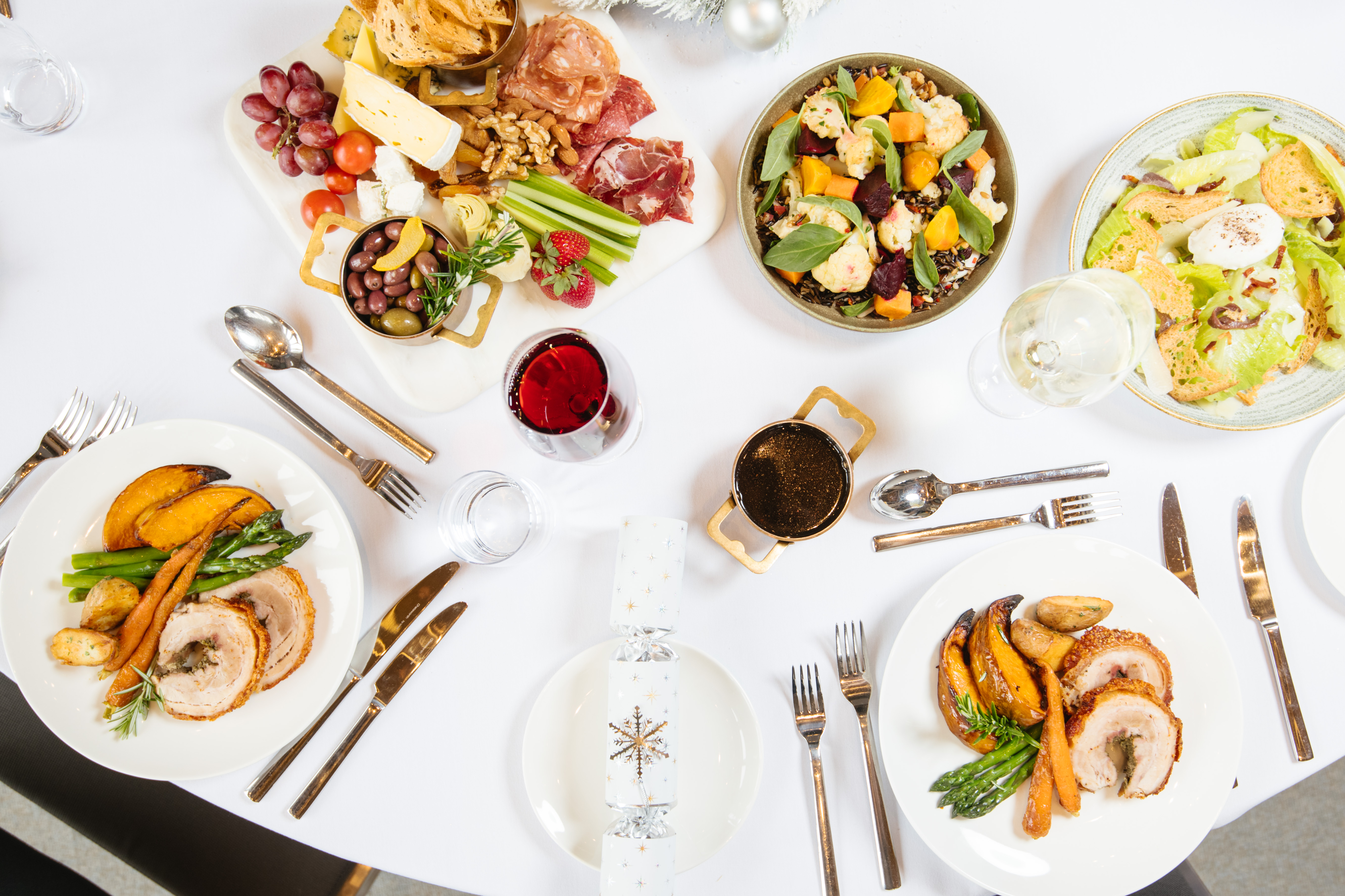 Birds eye view of plates of Christmas food