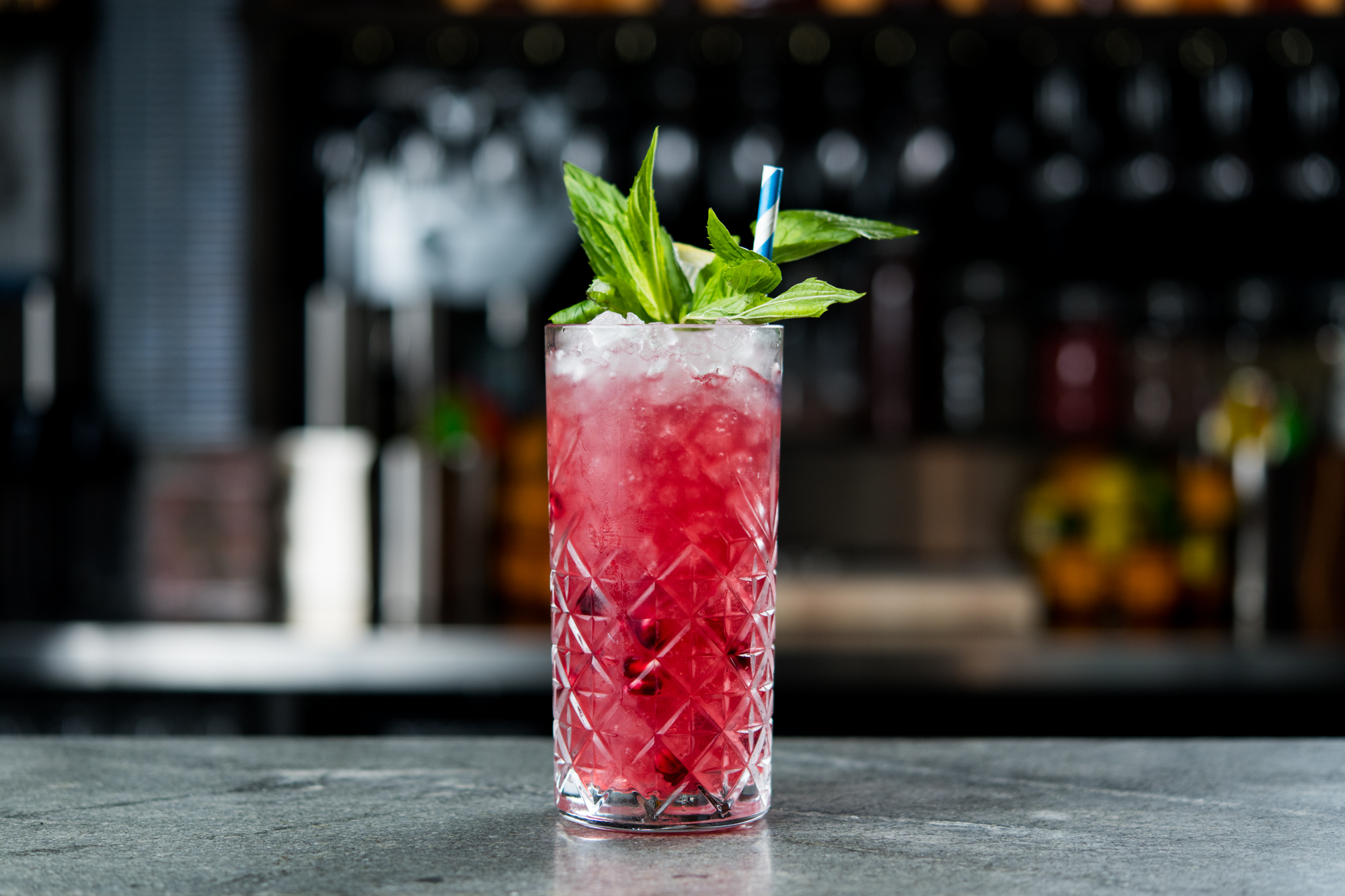 Red cocktail with green garnish