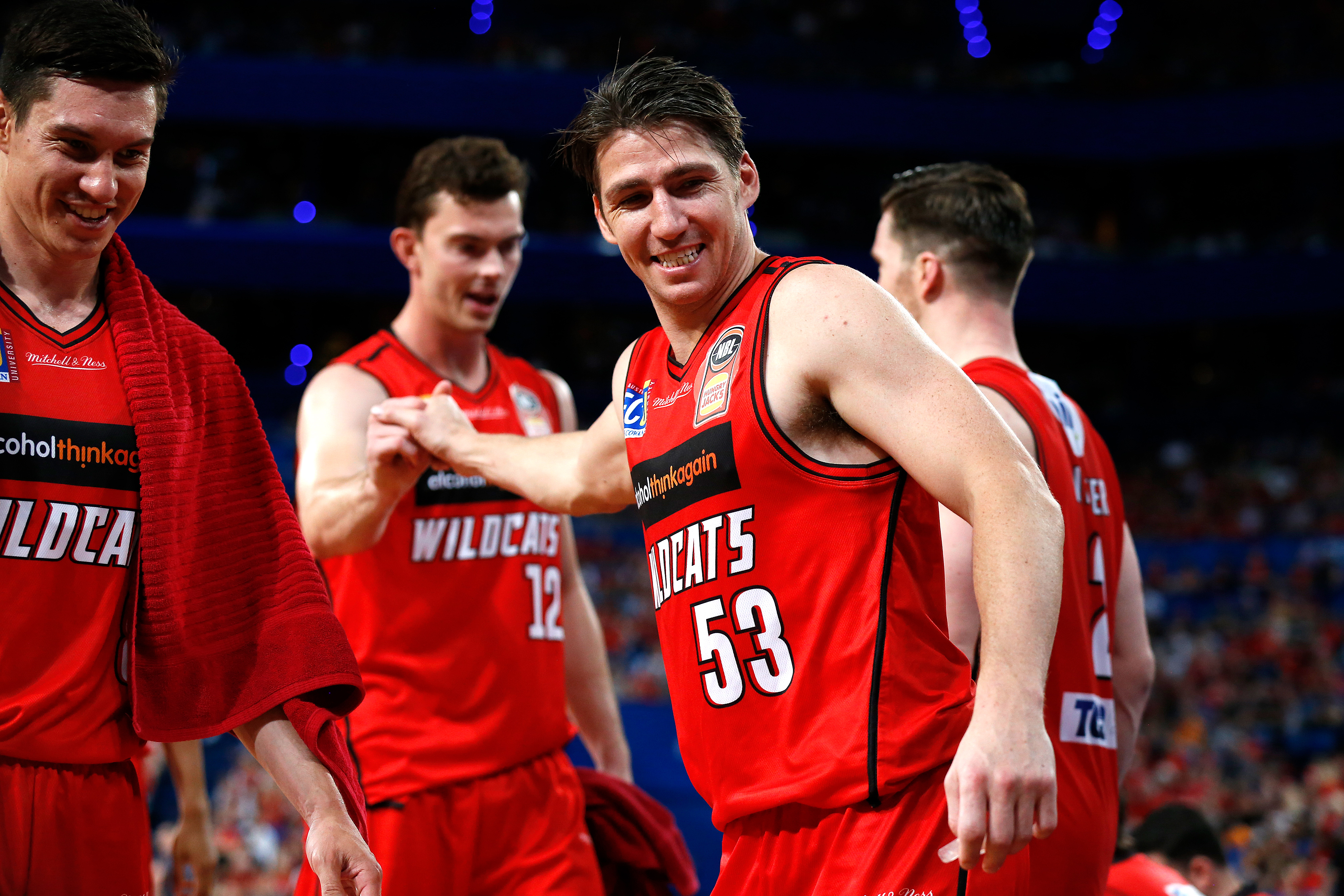 Perth Wildcats players congratulating each other