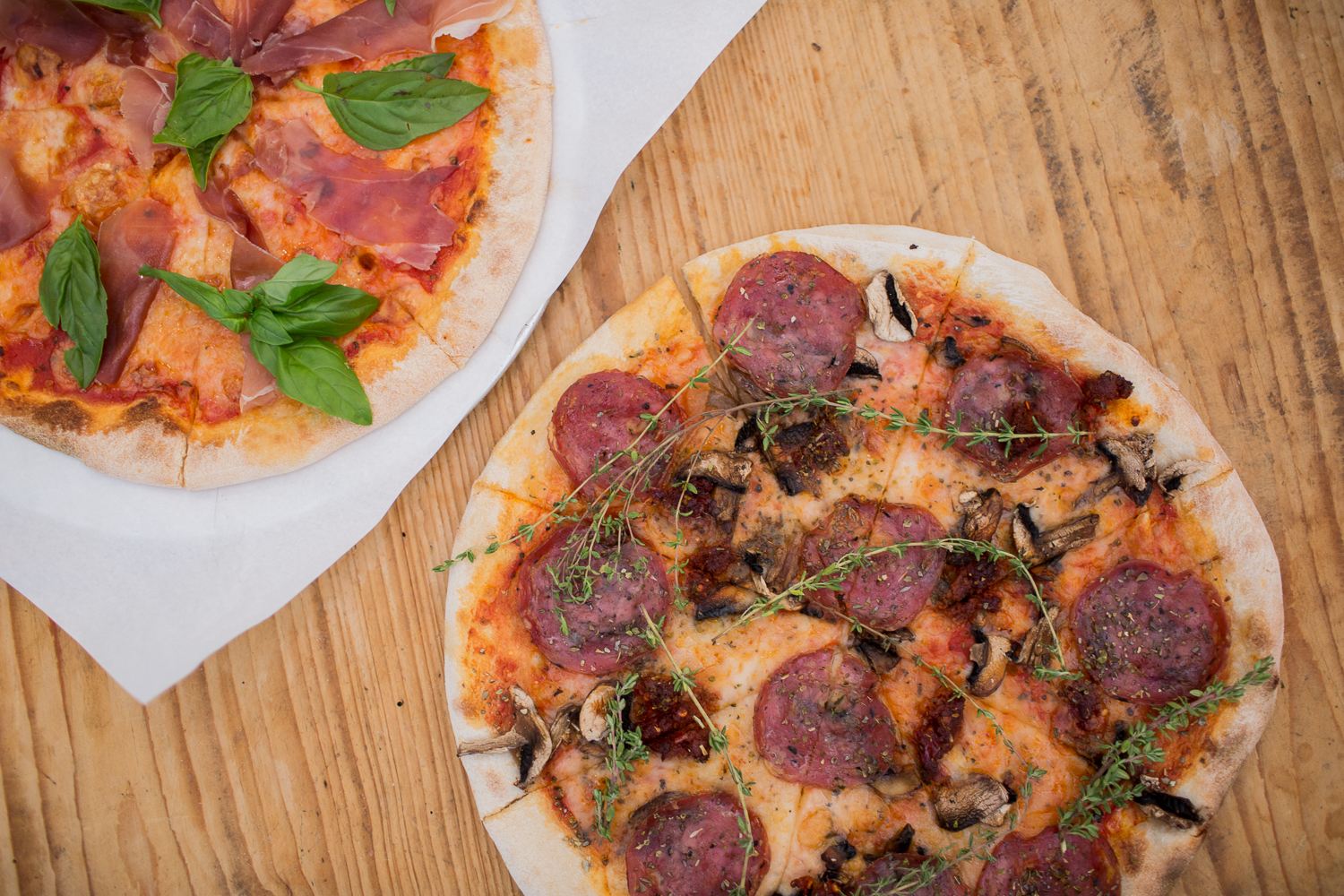 Our woodfired pizzas are the perfect accompaniment to our unique craft beers!