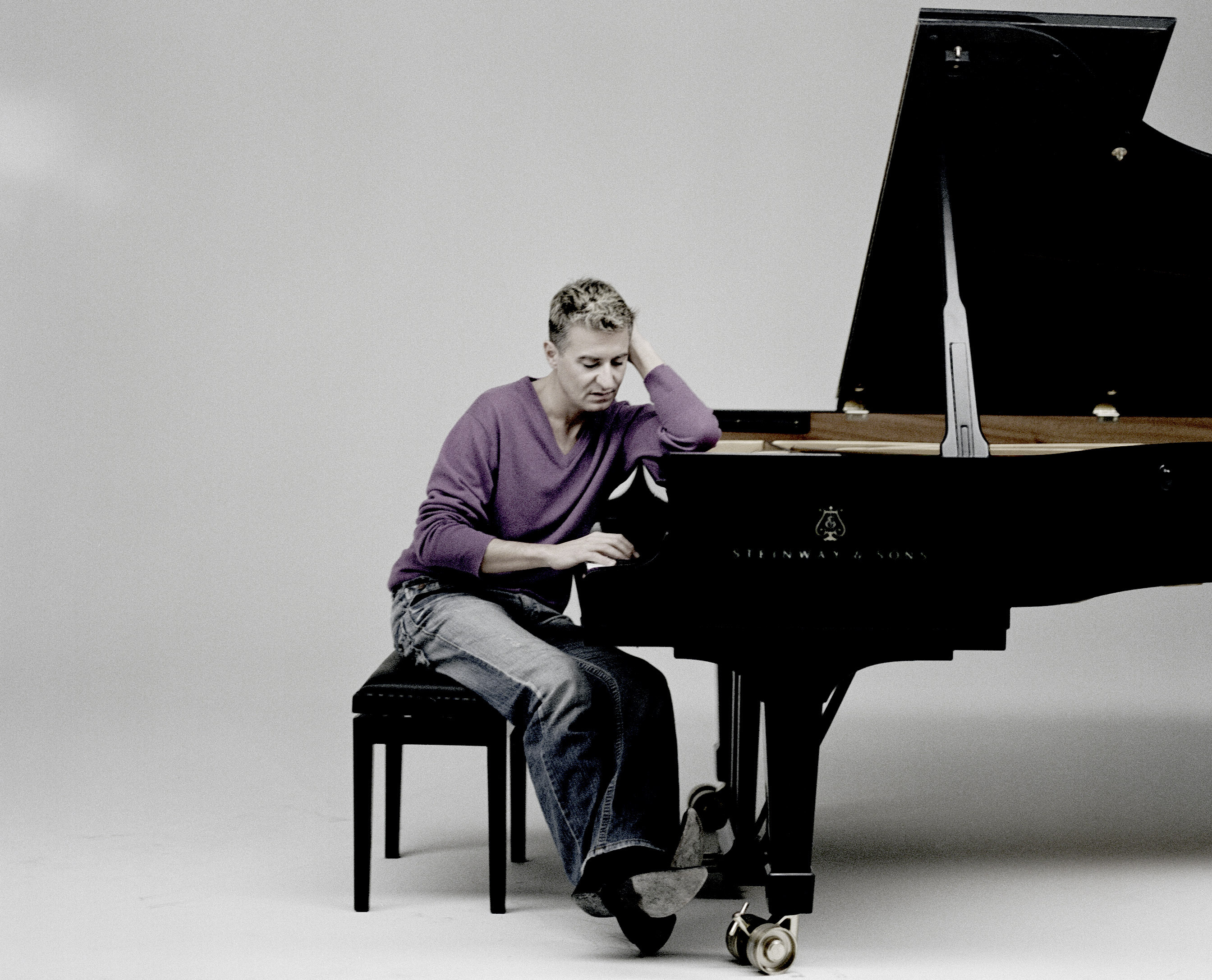 Man leaning on piano