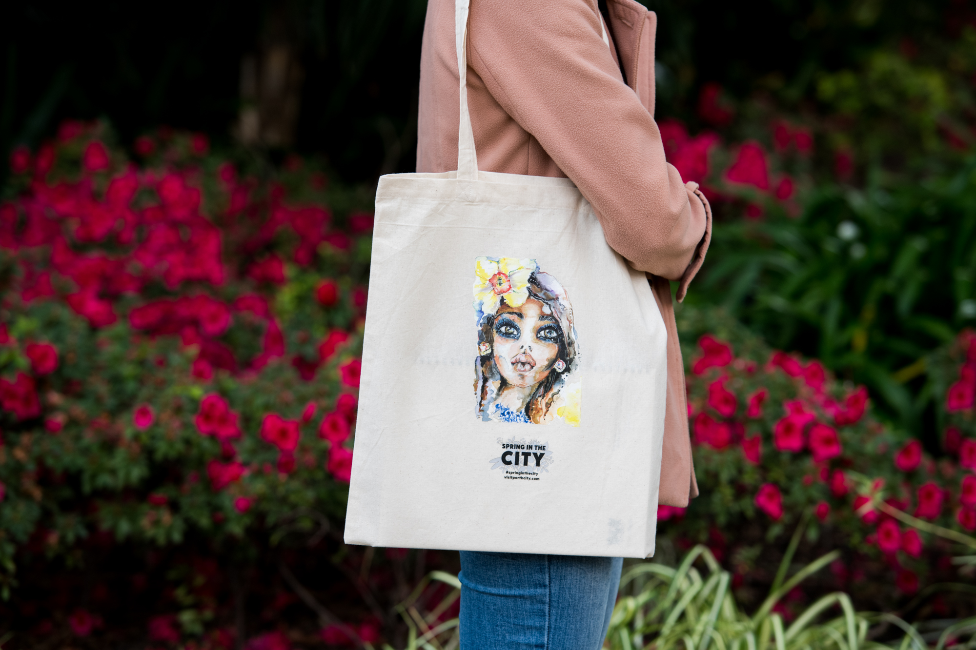 Person holding tote bag