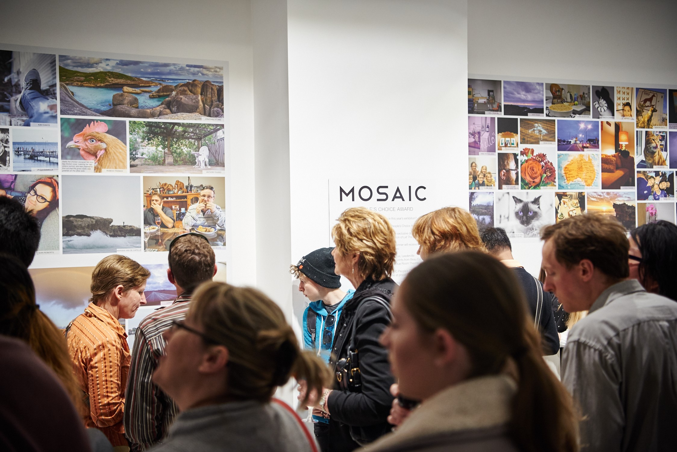 Crowd viewing a photo exhibition