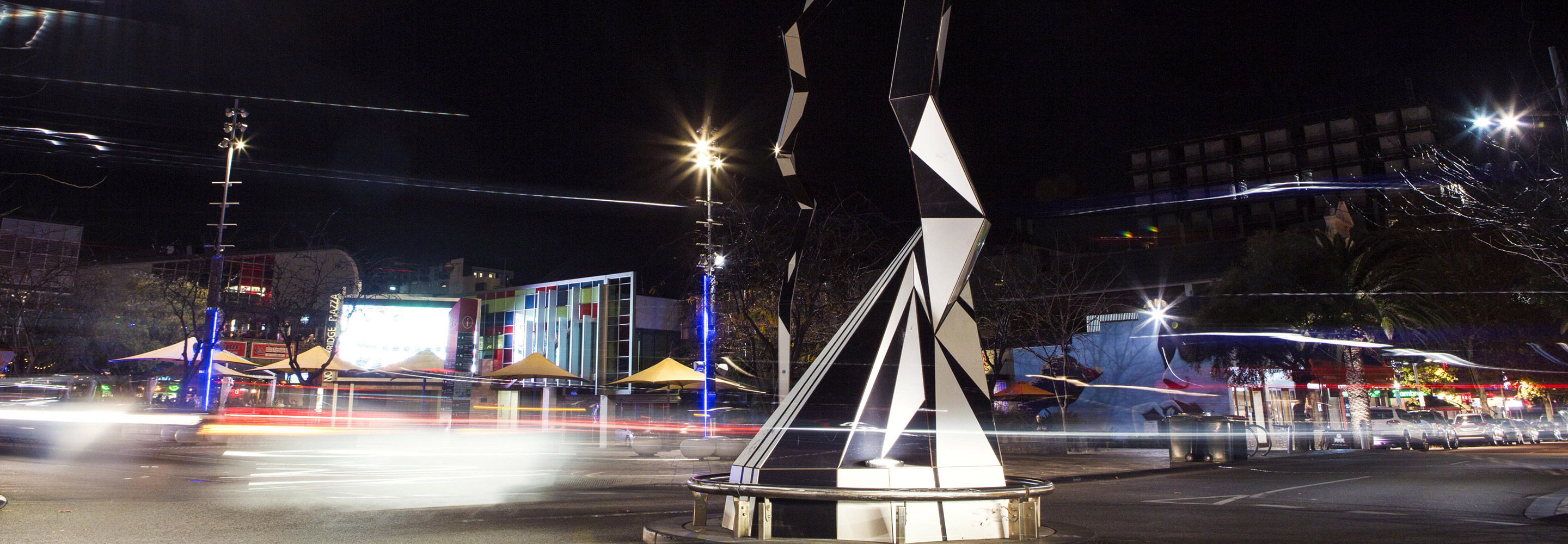 Modern sculpture in road in dark